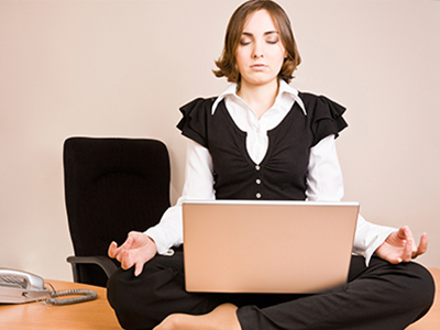 Woman meditating on her desk