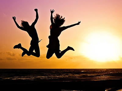 Happy women jumping