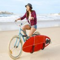 Woman riding a bike on the beach
