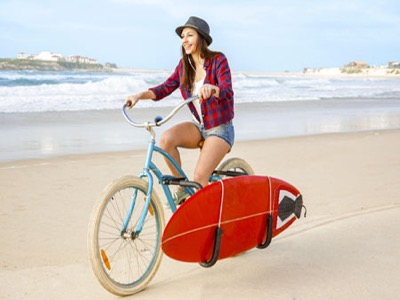 Woman riding a bike on the beach