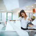 busy woman at photocopier featured