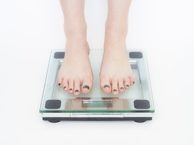 woman on scales featured