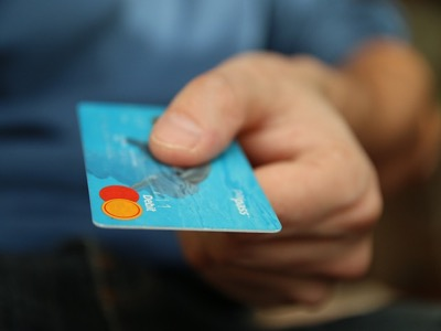 man paying with credit card featured