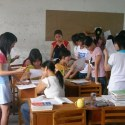 classroom of female students talking featured