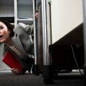 competitive workplace woman looking scared featured