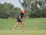 female golfer playing at golf club featured