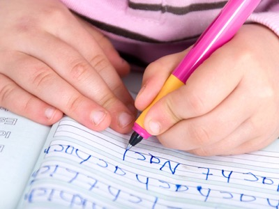 child learning to write featured