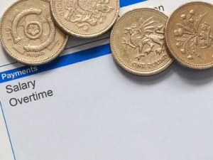 wage slip with pound coins featured