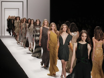 fashion models walking down the catwalk featured