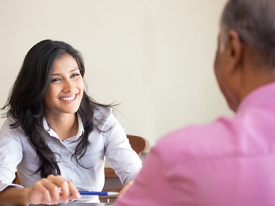 woman-being-supported-by-male-colleague-featured