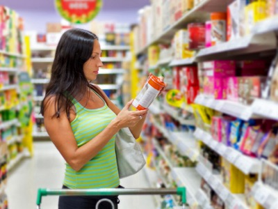 woman shopping at the supermarket featured