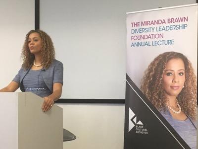 Miranda Brawn Diversity Lecture on a podium talking