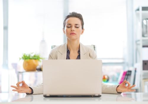 business-woman-meditating-at-her-desk-meditation