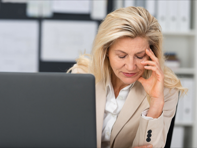 Blonde woman upset by her laptop, unhappy about the gender gap