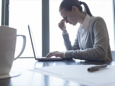 gender pay-gap woman stressed in desk