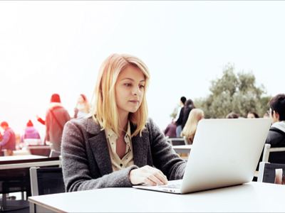 young attractive woman at her laptop searching for jobs