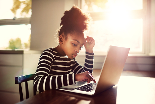 young-girl-working-on-a-computer-stem, Montessori education
