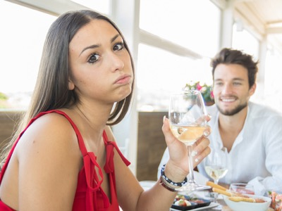 woman-looking-sad-on-a-date-featured