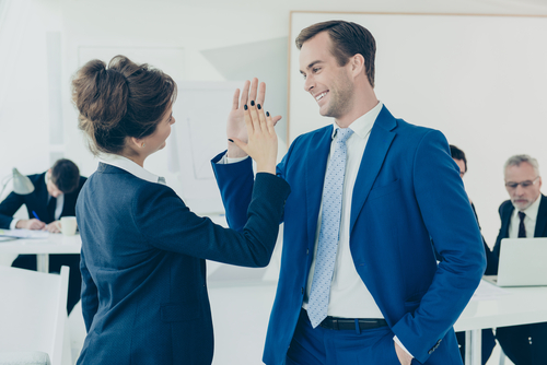 colleagues giving an office high-five