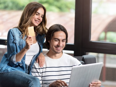 millennial couple paying for items featured