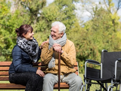 carer looking after elderly man featured
