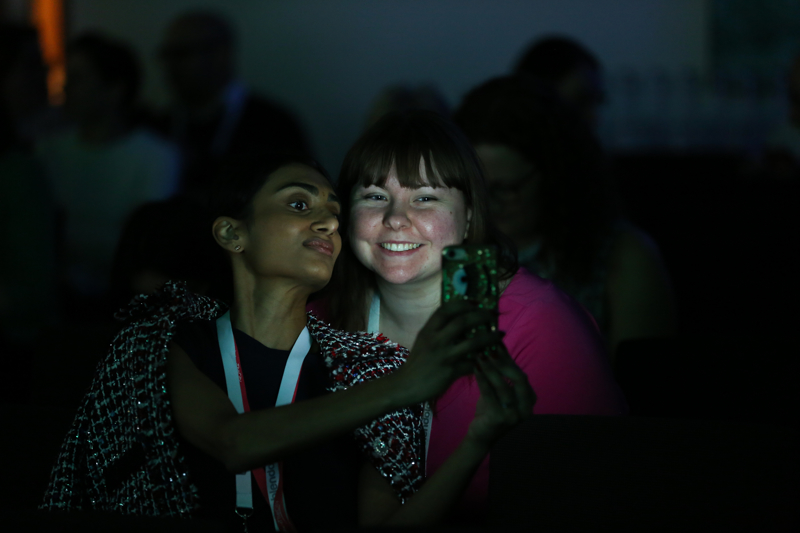 Delegates taking selfies at the WeAreTechWomen conference