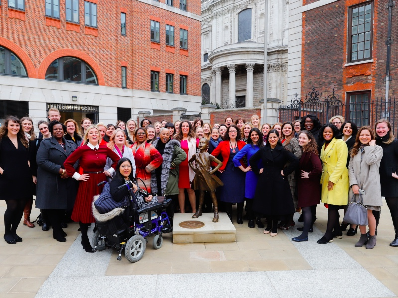 Gender Networks standing in front of the Fearless Girl statue