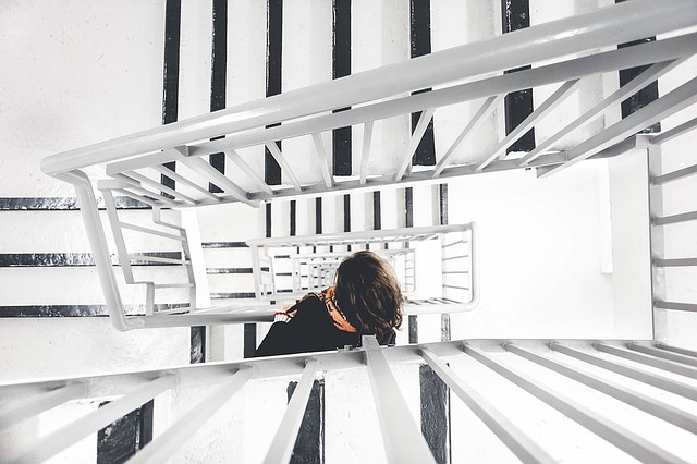 career journey, woman climbing stairs