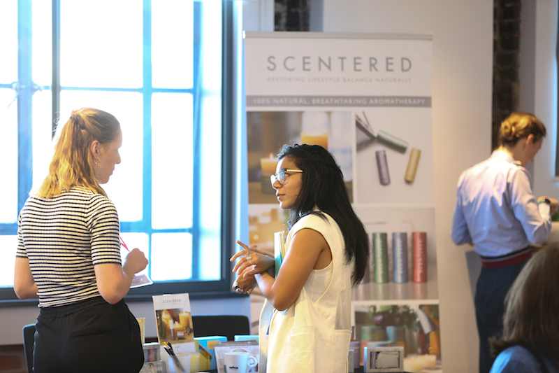Delegates at the Scentered marketplace stand