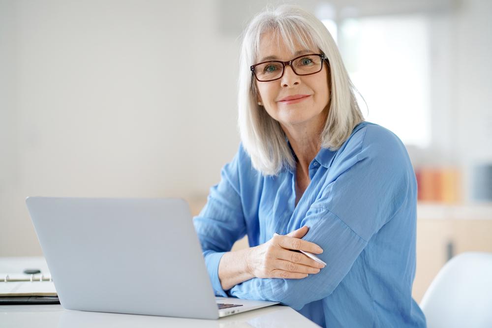 Senior businesswoman working in office, menopause