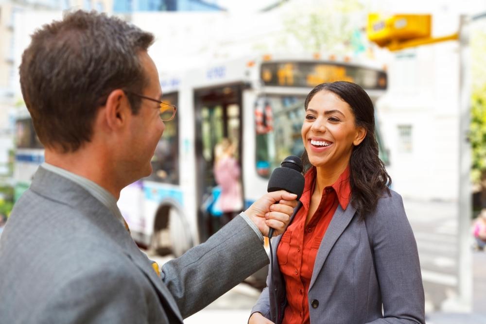 female spokesperson, press interview