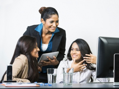 Diverse women in a meeting featured