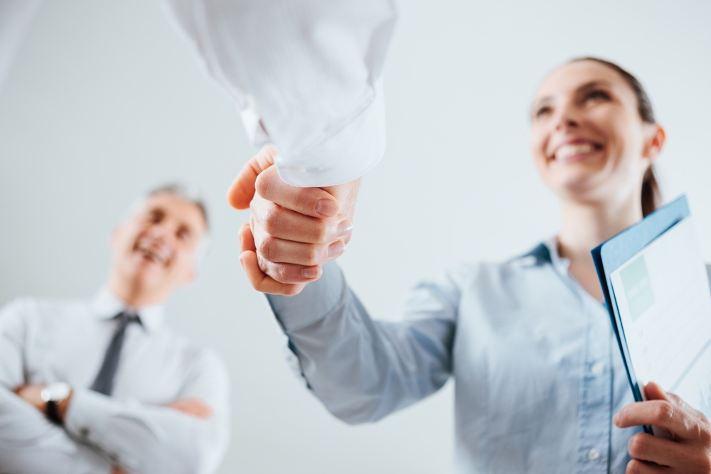 woman shaking hands, job interview, strengths, employable
