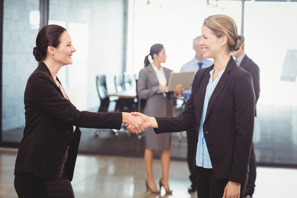 job interview, handshake, two women shaking hands, weakness