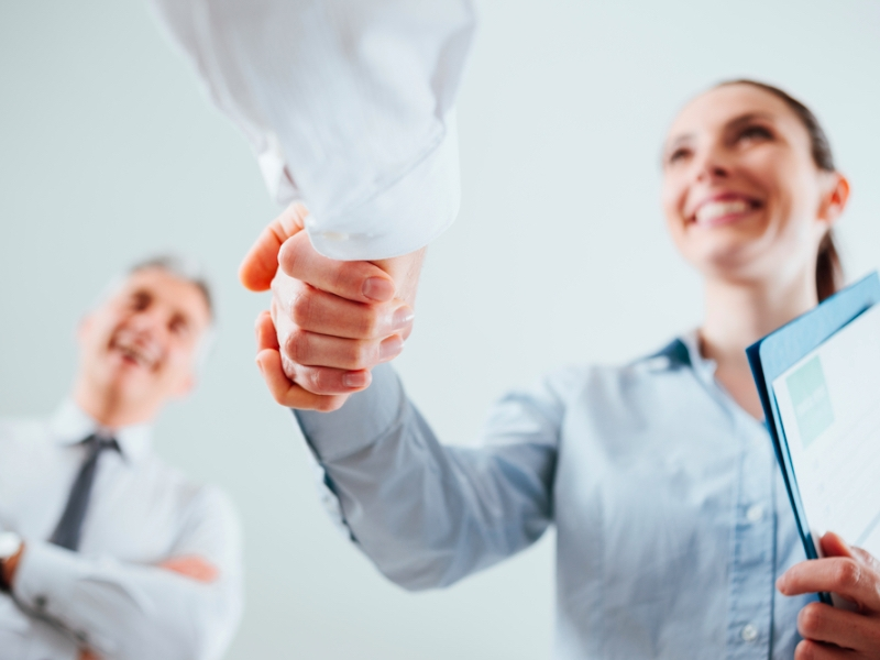 woman shaking hands, job interview, strengths, personal impact