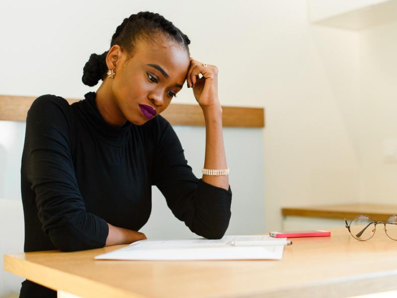 Sad woman at desk, Blue Monday