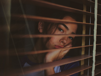 sad woman looking out of her window, Blue Monday