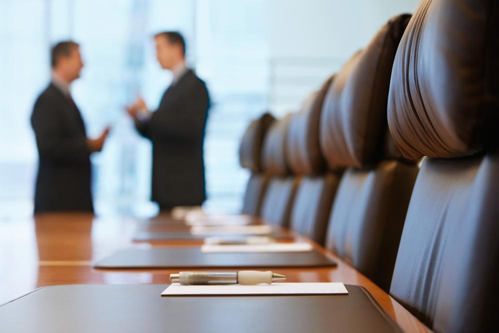 CEOs talking in a boardroom