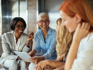 Happy business woman working together online on a tablet, menopause
