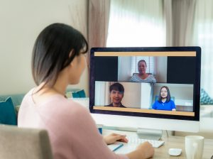 woman remote working on video conference call