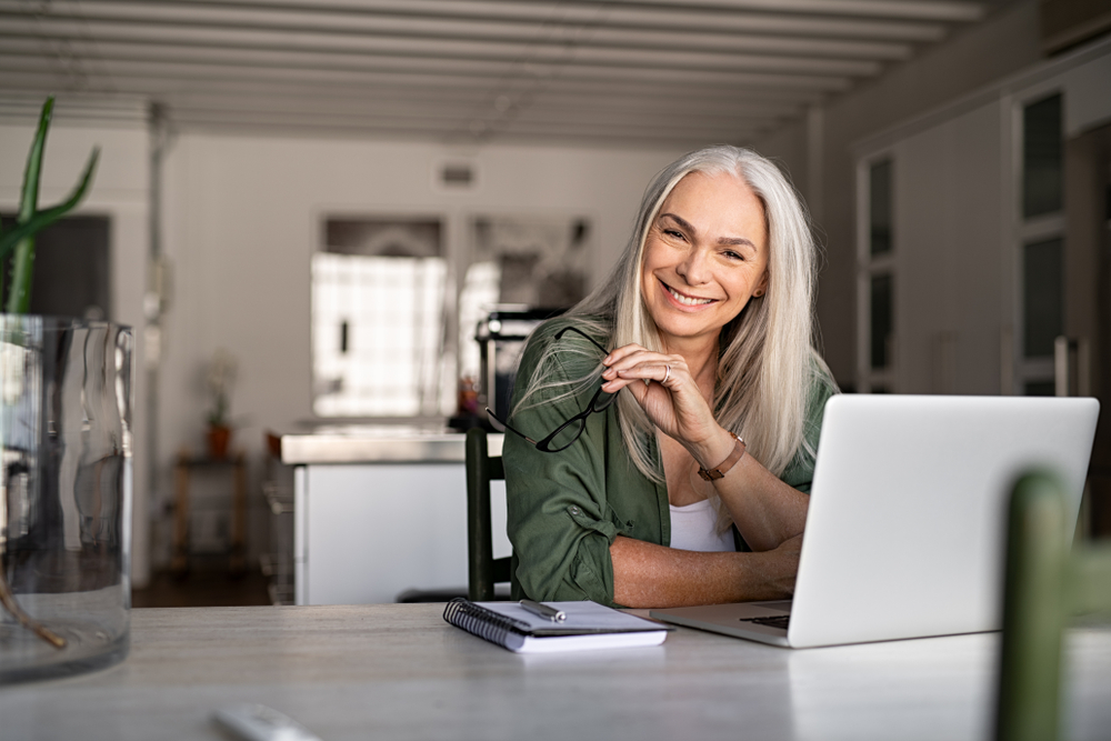 happy woman working from home, flexible working, emotional wellbeing