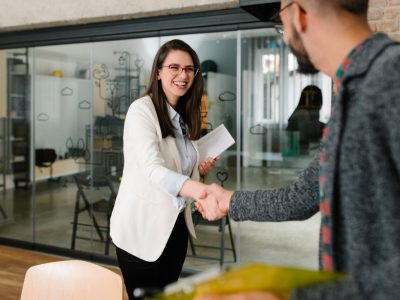Openly greeting a job recruiter with a firm handshake, recruitment industry, new role