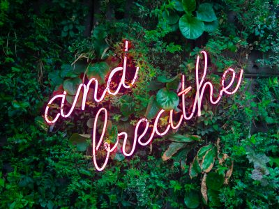 and breathe neon sign, wellness