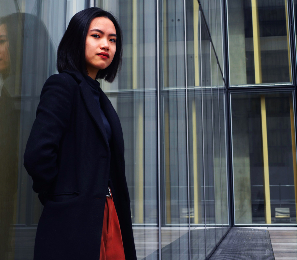asian woman standing outside her work, returning to work, return to work