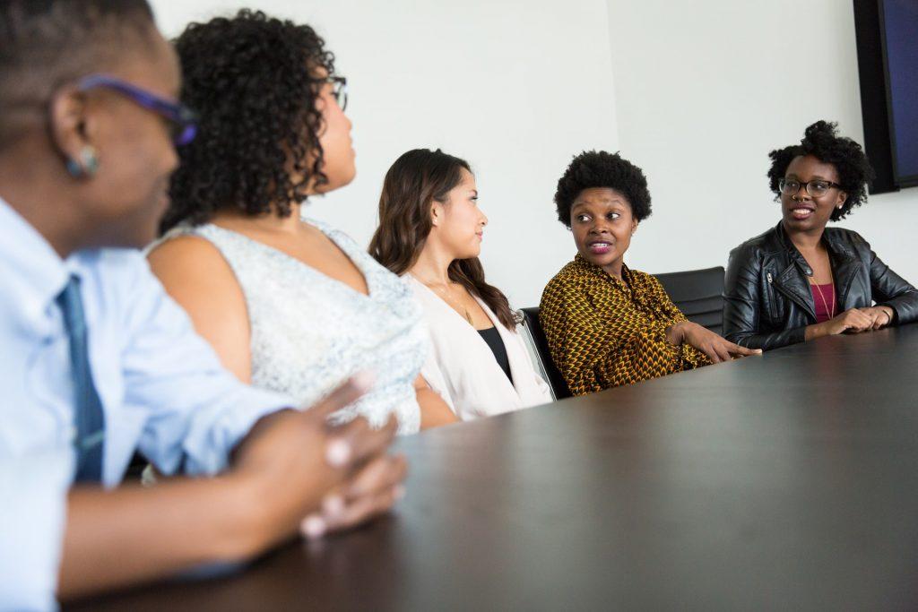 boardroom of diverse people, diversity, black inclusion, successful leader