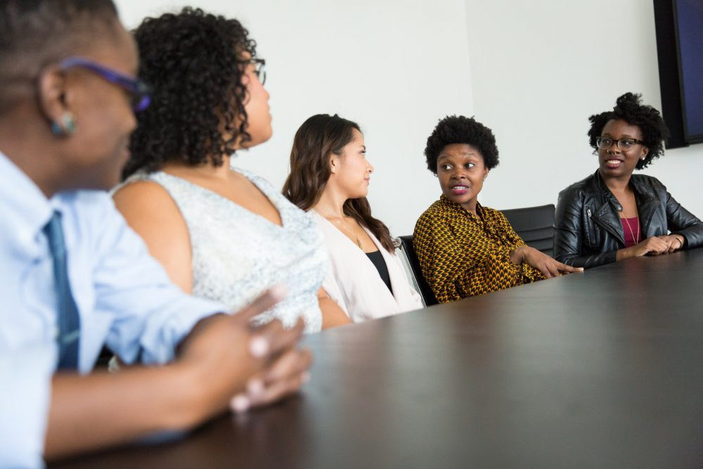 boardroom of diverse people, diversity, black inclusion, black colleagues