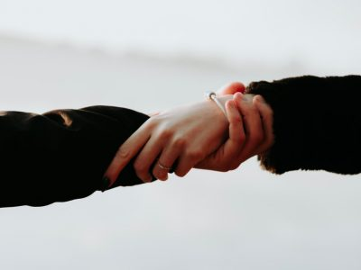 man and woman holding hands, mental health, wellbeing, mindfulness