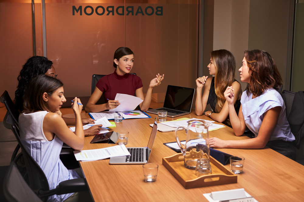 Businesswomen at an evening meeting in a boardroom, women on boards