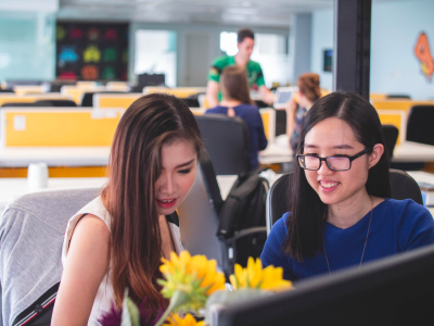 Two Asian women working together in an office, working women