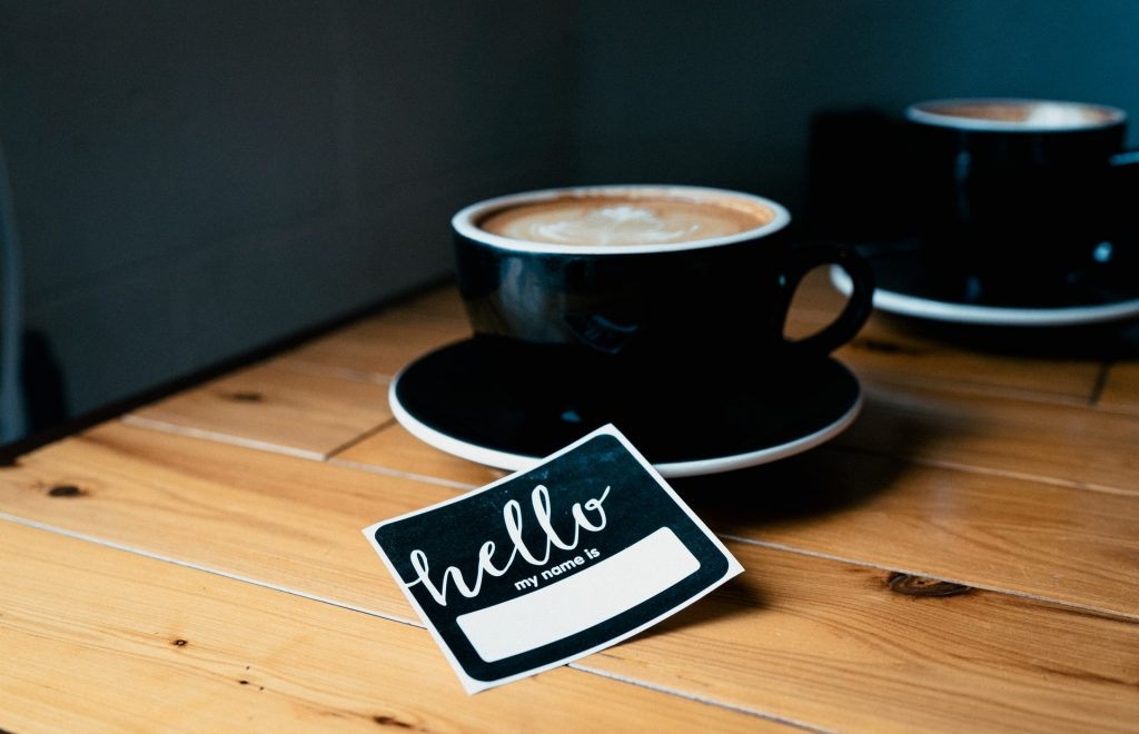 networking event, name badge and coffee, network